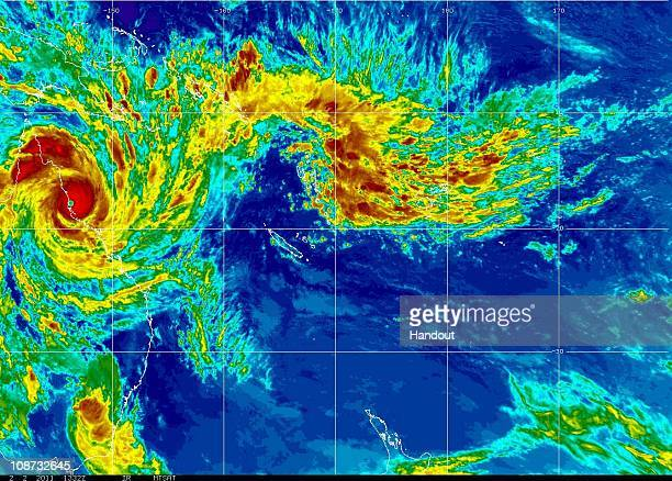 In this handout MTSAT satellite image from the National Oceanic and Atmosphere Administration a category five cyclone hits land on the north coast of...