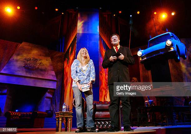 In this handout photo author JK Rowling and actor Stephen Fry rehearse on stage prior to the reading of Rowling's new book 'Harry Potter And The...