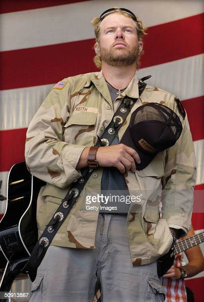 In this handout photo country music star Toby Keith holds his cap over his heart during a moment of honor during a Memorial Day performance at Storck...