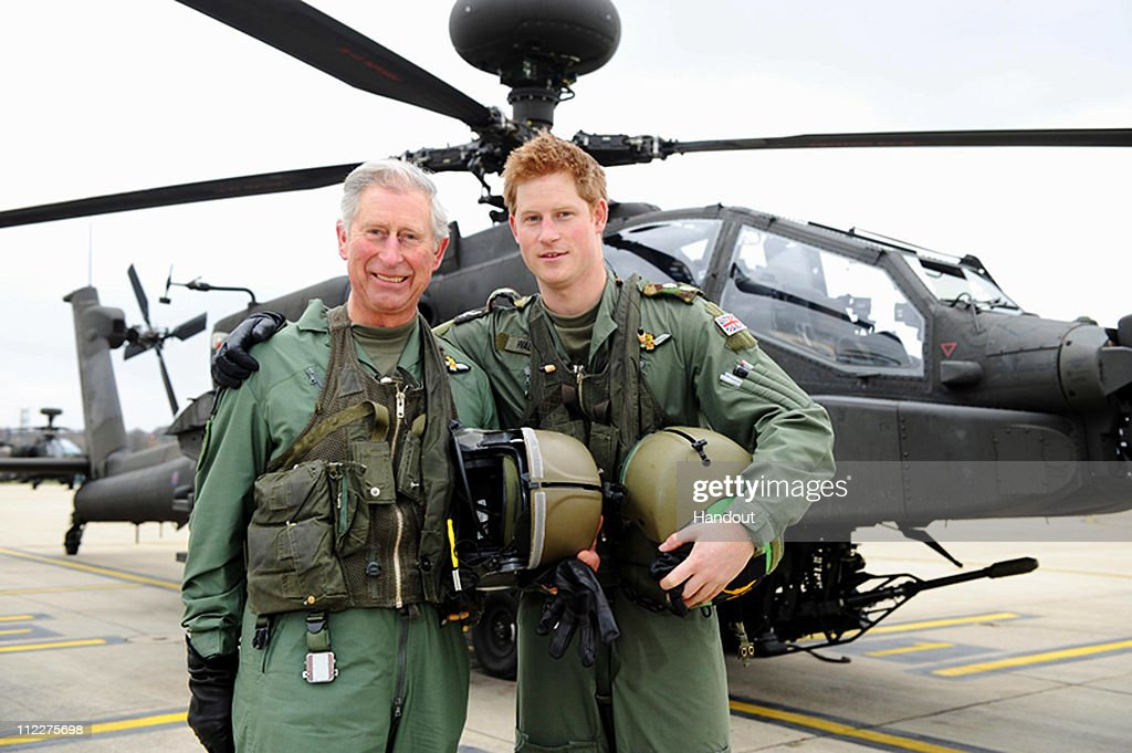 In this handout photo, dated March 21, 2011, issued by the Ministry of Defence,<a gi-track='captionPersonalityLinkClicked' href=/galleries/search?phrase=Prince+Harry&family=editorial&specificpeople=178173 ng-click='$event.stopPropagation()'>Prince Harry</a> and his father, the <a gi-track='captionPersonalityLinkClicked' href=/galleries/search?phrase=Prince+Charles&family=editorial&specificpeople=160180 ng-click='$event.stopPropagation()'>Prince Charles</a>, Prince of Wales, stand in front of an Apache Helicopter after <a gi-track='captionPersonalityLinkClicked' href=/galleries/search?phrase=Prince+Charles&family=editorial&specificpeople=160180 ng-click='$event.stopPropagation()'>Prince Charles</a> was invited by the Army Aviation Centre in his role as Colonel-in-Chief of the Army Air Corps (AAC) in order to fly an Apache and to meet students on the Apache Conversion Course on March 21, 2011 in Middle Wallop, England. The announcement by St James's Palace comes a few days after the royal, a trainee Apache helicopter pilot, passed the half-decade milestone. (Photo by Richard Dawson/MoD via Getty Images)