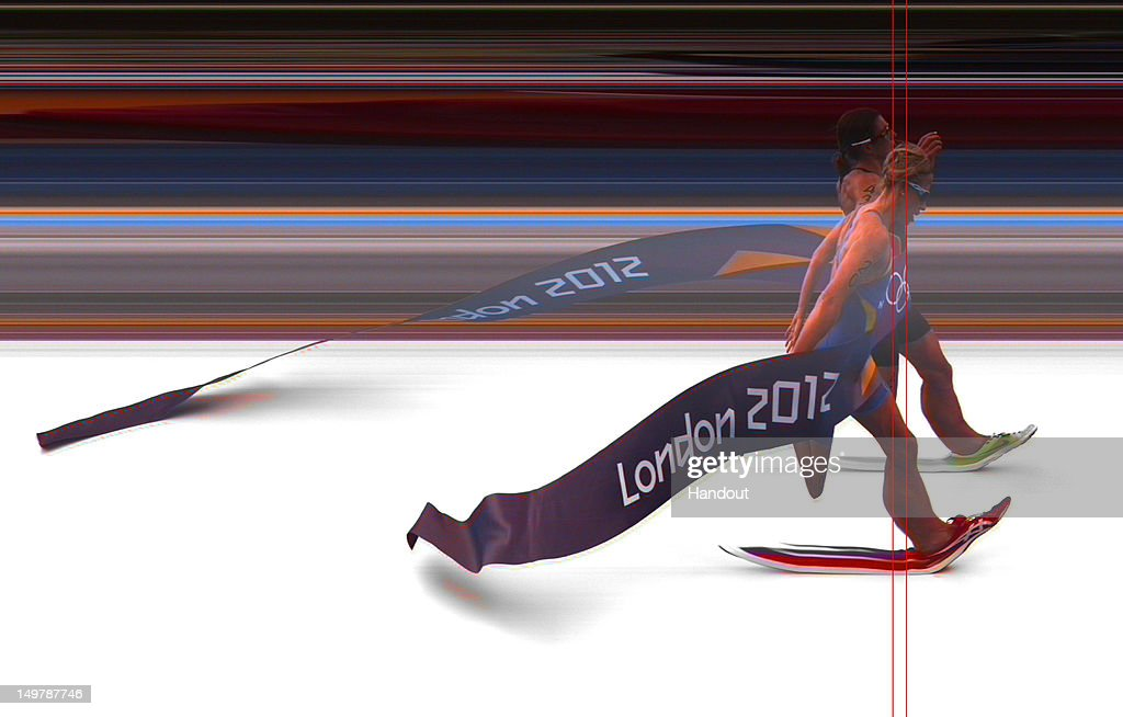 In this handout photo finish image supplied by Omega, Lisa Norden of Sweden is beaten by Nicola Spirig (Far Side) of Switzerland as they finish the Women's Triathlon on Day 8 of the London 2012 Olympic Games at Hyde Park on August 4, 2012 in London, England.