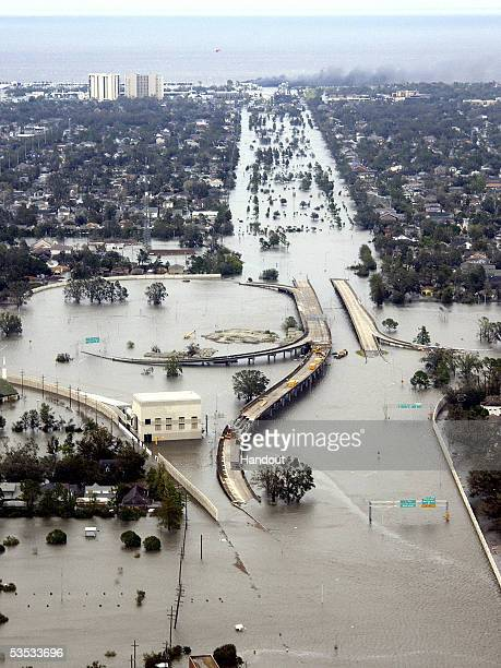 In this handout photo flooded roadways can be seen as the Coast Guard conducts initial Hurricane Katrina damage assessment over flights August 29...