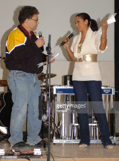 In this handout photo from 2006 provided by the US Army Al Franken and Leann Tweeden entertain the Soldiers with a skit at Forward Operating Base...