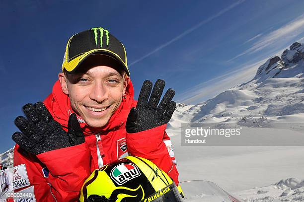 In this handout photo from Ducati Valentino Rossi of Italy and Ducati poses for a photo during the 2011 Wroom F1 and Moto GP Press Ski Meeting on...