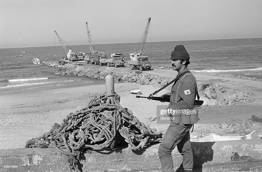 In this handout photo from the GPO an Israeli soldier on guard during construction of the Palestinian port more than seven years after the 1967...