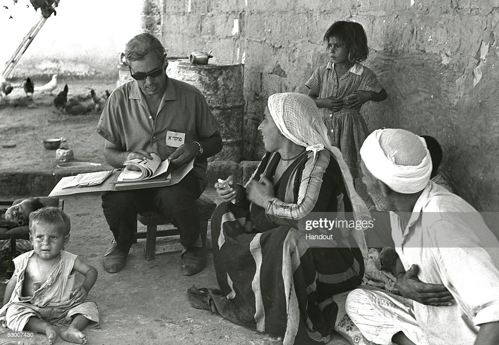 In this handout photo from the GPO Israeli census taker Josef Levy interviews a Palestinian family in their courtyard just three months after the...