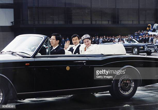 In this handout photo from the Imperial Household Agency Crown Prince Naruhito of Japan and his wife Crown Princess Masako leave the Imperial Palace...