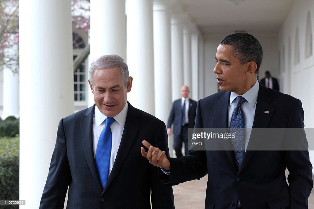 In this handout photo from the Israeli Government Press Office (GPO), U.S. President <a gi-track='captionPersonalityLinkClicked' href=/galleries/search?phrase=Barack+Obama&family=editorial&specificpeople=203260 ng-click='$event.stopPropagation()'>Barack Obama</a> (R) talks with Prime Minister <a gi-track='captionPersonalityLinkClicked' href=/galleries/search?phrase=Benjamin+Netanyahu&family=editorial&specificpeople=118594 ng-click='$event.stopPropagation()'>Benjamin Netanyahu</a> as they walk along the Colonnade of the White House on March 5, 2012 in Washington, DC. The two leaders discussed peace in the Middle East and Israel's growing concerns with Iran producing nuclear weapons.