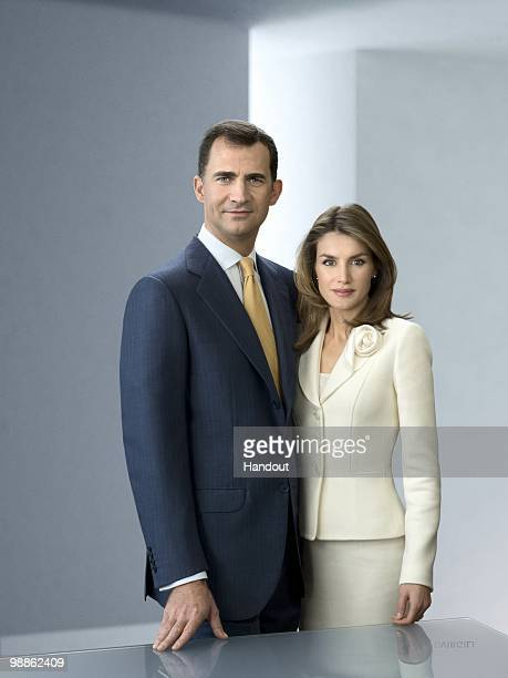 In this handout photo from the Spanish Royal Household Prince Felipe and Princess Letizia of Spain pose for an official portrait session at Zarzuela...