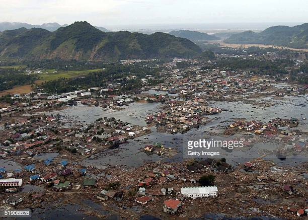 In this handout photo from the US Navy a view of the landscape a week after a tsunami swept through i seen January 2 2005 in Sumatra Indonesia US...