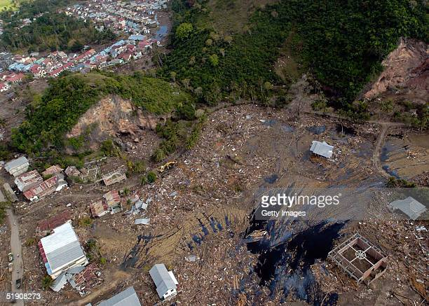 In this handout photo from the US Navy a view of the landscape after the tsunami swept through over Banda Aceh on January 1 2005 in Sumatra Indonesia...