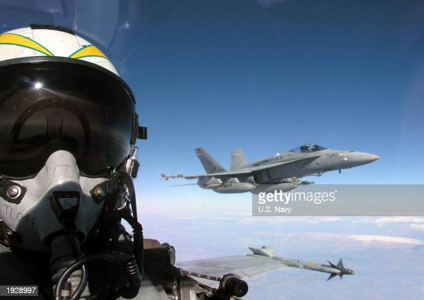 In this handout photo from the US Navy two Hornet warplanes fly close air support missions for coalition special operation forces involved in the...
