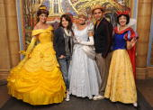 In this handout photo from Walt Disney World actors dressed as princesses Belle Cinderella and Snow White pose with '30 Rock' actress and executive...