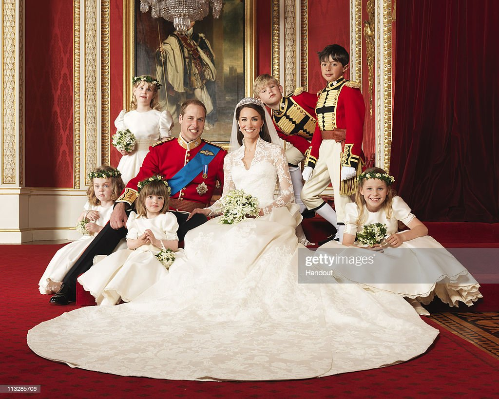 In this handout photo, issued by St James's Palace, the bride and groom Prince William, Duke of Cambridge and Catherine, Duchess of Cambridge pose for an official photo with (clockwise from bottom right) The Hon. Margarita Armstrong-Jones, Miss Eliza Lopes, Miss Grace van Cutsem, Lady Louise Windsor, Master Tom Pettifer, Master William Lowther-Pinkerton, in the throne room at Buckingham Palace on April 29, 2011in London, England. The marriage of Prince William and Catherine Middleton was led by the Archbishop of Canterbury and was attended by 1900 guests, including foreign Royal family members and heads of state. Thousands of well-wishers from around the world have also flocked to London to witness the spectacle and pageantry of the Royal Wedding.