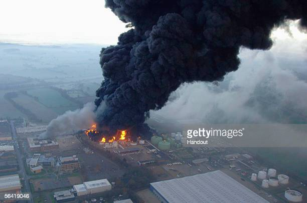 In this handout photo issued today by Hertfordshire Police black smoke billows from the continuing fire at one of the country's biggest oil depots on...