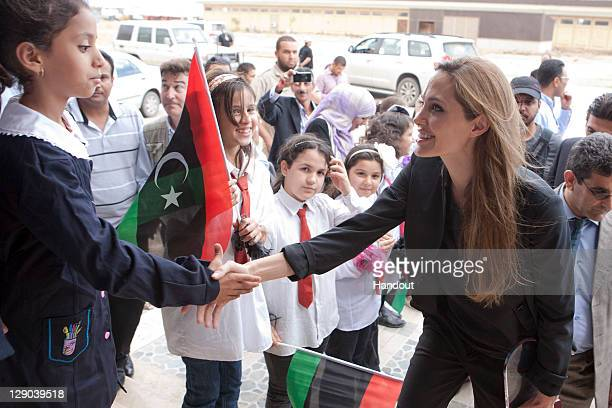 In this handout photo privided by UNHCR actress and UN Goodwill Ambassador Angelina Jolie visits Libya to help agencies bringing aid to Libyans in...