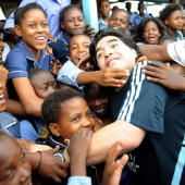 In this handout photo provided by 2010 FIFA World Cup Organising Committee South Africa Argentina national soccer team's head coach Diego Maradona is...