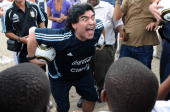 In this handout photo provided by 2010 FIFA World Cup Organising Committee South Africa Argentina national soccer team's head coach Diego Maradona...