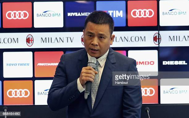 In this handout photo provided by AC Milan New AC Milan Owner and President Yonghong Li attends a press conference to unveil AC Milan new owners on...