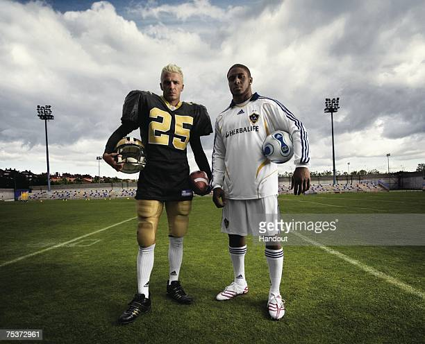 In this handout photo provided by Adidas LA Galaxy star signing David Beckham and New Orleans Saints star Reggie Bush swap kits as they launch the...