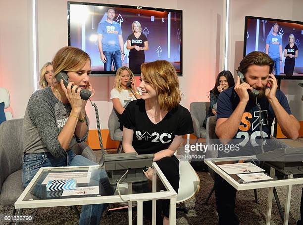 In this handout photo provided by American Broadcasting Companies Inc actors Kristen Wiig Emma Stone and Bradley Cooper attend Stand Up To Cancer a...