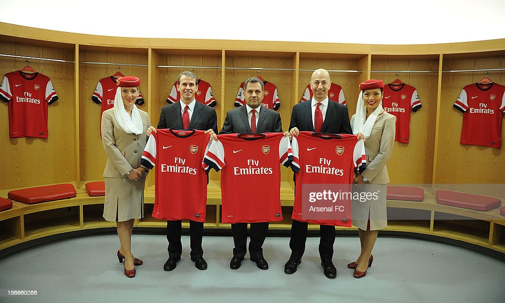 In this handout photo provided by Arsenal FC Arsenal Football Club, (L-R) Arsenal Chief Commercial officer Tom Fox, Divisional Senior Vice President - Corporate Communications of Emirates Airlines Boutros Boutros and Arsenal CEO Ivan Gazidis announce new commercial partnership with Emirates Airlines at Emirates Stadium on November 23, 2012 in London, England. (Photo by Stuart MacFarlane/Arsenal FC via Getty Images