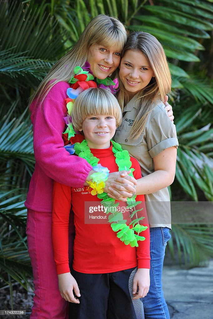 In this handout photo provided by Australia Zoo, Bindi Irwin celebrates her 15th birthday with her mother Terri Irwin and brother Robert Irwin, on July 24, 2013 in Beerwah, Australia.