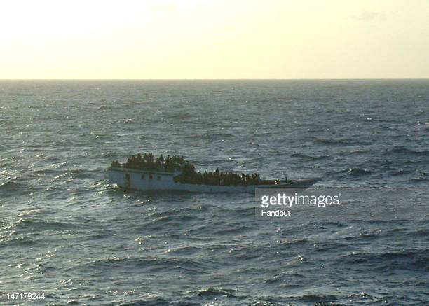 In this handout photo provided by Australian Maritime Safety Authority a boat carrying 150 suspected asylum seekers is spotted by crew onboard MV...