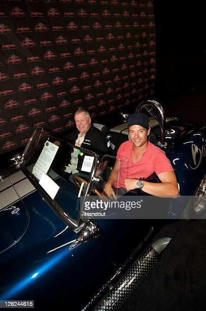 In this handout photo provided by BarrettJackson actor Josh Duhamel with BarrettJackson CEO Craig Jackson makes a special appearance at the 4th...