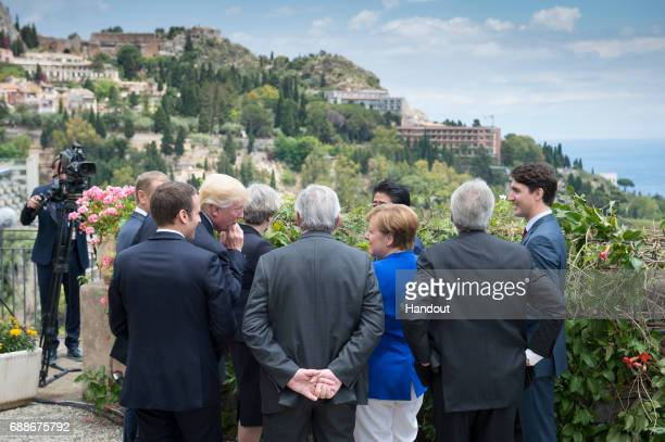 In this handout photo provided by BPA G7 leaders Canadian Prime Minister Justin Trudeau French President Emmanuel Macron US President Donald Trump...