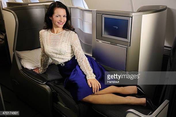 In this handout photo provided by British Airways Sex and the City star Kristin Davis stretches out on the flat bed in Club World onboard British...