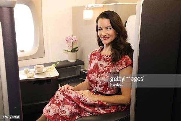 In this handout photo provided by British Airways Sex and the City star Kristin Davis relaxes in the luxurious First class cabin onboard British...