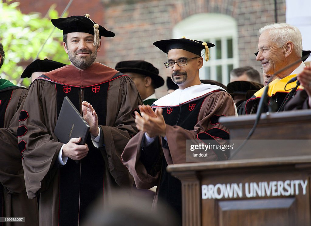 In this handout photo provided by Brown University, actor/director <a gi-track='captionPersonalityLinkClicked' href=/galleries/search?phrase=Ben+Affleck&family=editorial&specificpeople=201856 ng-click='$event.stopPropagation()'>Ben Affleck</a> receives an honorary Doctor of Fine Arts degree from Brown University at the 245th Commencement ceremony on May 26, 2013 in Providence, Rhode Island.