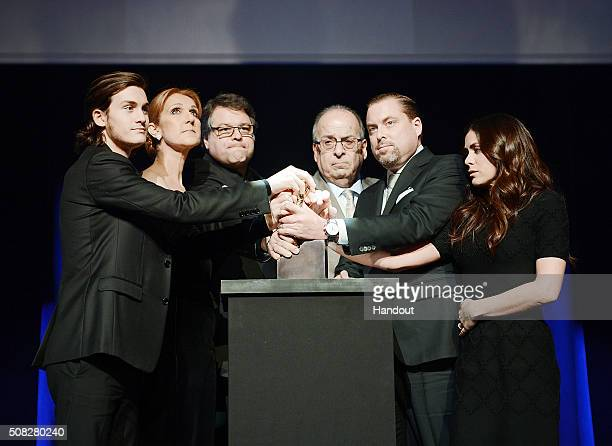 In this handout photo provided by Caesars Palace ReneCharles Angelil Celine Dion Patrick Angelil Andre Angelil JeanPierre Angelil and AnneMarie...