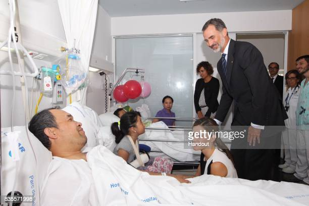 In this handout photo provided by Casa de SM el Rey de Espana King Felipe VI of Spain and Queen Letizia of Spain visits victims of last Thursday's...