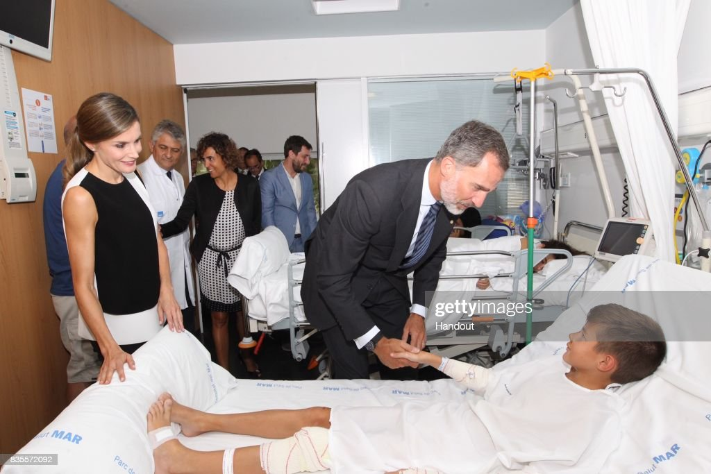 In this handout photo provided by Casa de S.M. el Rey de Espana, King Felipe VI of Spain and Queen Letizia of Spain visits a victim of last Thursday's terrorist attack at the Hospital de la Santa Creu i Sant Pau on August 19, 2017 in Barcelona, Spain. Thirteen people were killed and dozens injured in the Las Ramblas area of Barcelona when a van hit crowds on August 17.