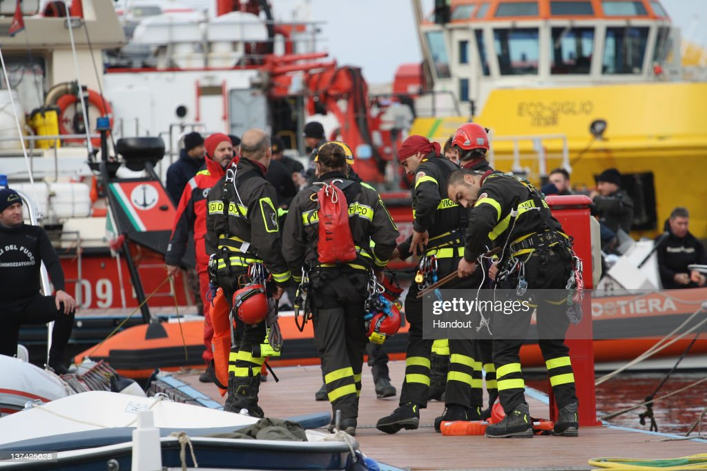 In this handout photo provided by Corpo Nazionale dei Vigili del Fuoco, Firefighters prepare to work on the cruise ship Costa Concordia that lies grounded off the island of Giglio on January 19, 2012 in Italy. The rescue operation was temporarily suspended earlier due to the ship moving as it slowly sank further into the sea.