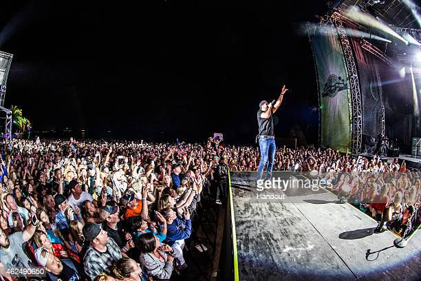 In this handout photo provided by Crash My Playa/aLIVE Coverage Luke Bryan performs during CID Presents Luke Bryan's Crash My Playa at the Barcelo in...