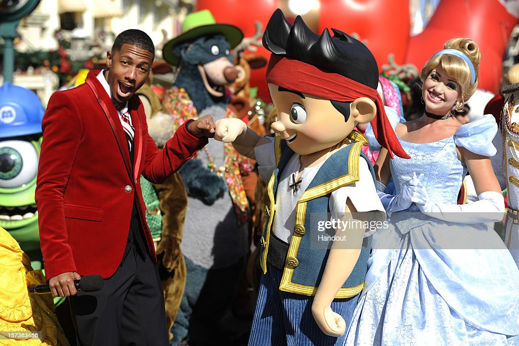 In this handout photo provided by Disney, actor Nick Cannon gives a fist-bump to Disney Junior character 'Jake' while taping the 'Disney Parks Christmas Day Parade' TV special in the Magic Kingdom park at Walt Disney World on December 1,2012 in Lake Buena Vista, Florida. Cannon is one of the hosts for the holiday special. Jake is the star of the Disney Junior series 'Jake and the Neverland Pirates.' The annual parade telecast, which airs Dec. 25, 2012 at various times across the country on ABC-TV, features celebrity performances and segments taped at Walt Disney World in Florida and Disneyland Resort in California. Featured performers include Lady Antebellum, Backstreet Boys, Brad Paisley, Phillip Phillips, Colbie Caillat, TobyMac, Yolanda Adams, Ross Lynch, the cast of 'Newsies' and a U.S. Marine Corps Band.