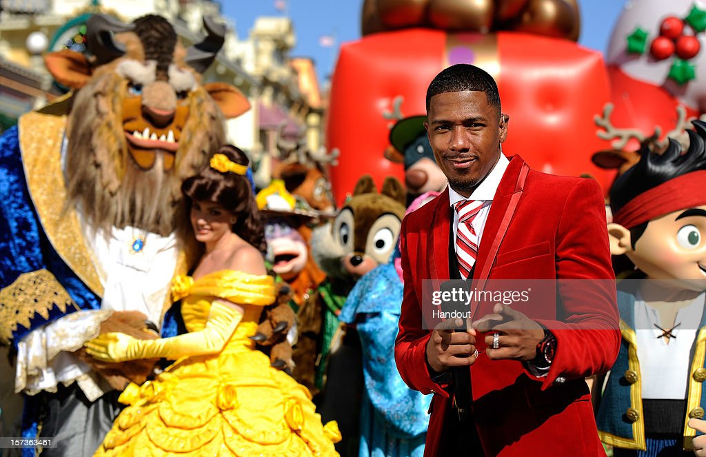 In this handout photo provided by Disney, actor Nick Cannon poses while taping the 'Disney Parks Christmas Day Parade' TV special in the Magic Kingdom park at Walt Disney World on December 1,2012 in Lake Buena Vista, Florida. Cannon is one of the hosts for the holiday special. The annual parade telecast, which airs Dec. 25, 2012 at various times across the country on ABC-TV, features celebrity performances and segments taped at Walt Disney World in Florida and Disneyland Resort in California. Featured performers include Lady Antebellum, Backstreet Boys, Brad Paisley, Phillip Phillips, Colbie Caillat, TobyMac, Yolanda Adams, Ross Lynch, the cast of 'Newsies' and a U.S. Marine Corps Band.