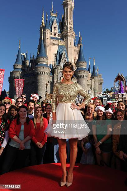 In this handout photo provided by Disney actress and entertainment journalist Maria Menounos poses during a break in taping the 'Disney Parks...