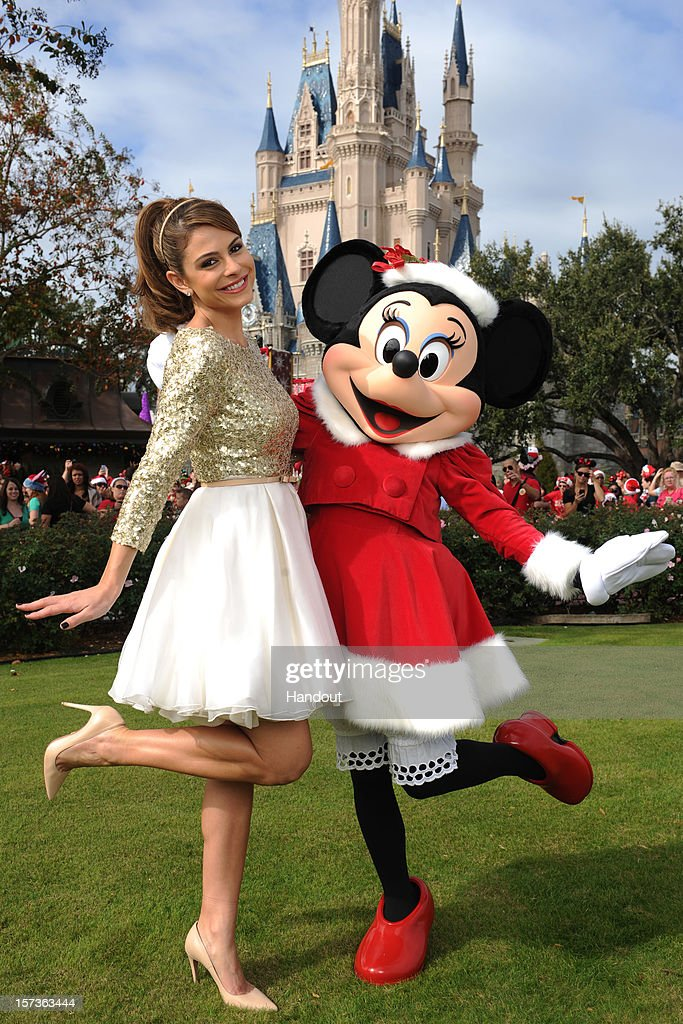 In this handout photo provided by Disney, actress and entertainment journalist Maria Menounos poses with Minnie Mouse during a break in taping the 'Disney Parks Christmas Day Parade' TV special in the Magic Kingdom park at Walt Disney World on December 1,2012 in Lake Buena Vista, Florida. Menounos is the co-host for the holiday special. The annual telecast, which airs Dec. 25, 2012 at various times across the country on ABC-TV, features celebrity performances and segments taped at Walt Disney World in Florida and Disneyland Resort in California. Featured performers include Lady Antebellum, Backstreet Boys, Brad Paisley, Phillip Phillips, Colbie Caillat, TobyMac, Yolanda Adams, Ross Lynch, the cast of 'Newsies' and a U.S. Marine Corps Band. Nick Cannon and Mario Lopez host the special.