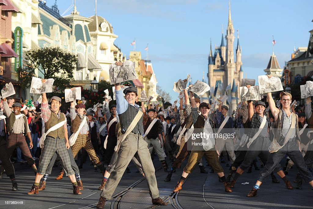 In this handout photo provided by Disney, cast members from Disney's Tony Award-winning musical 'Newsies' perform as they tape a segment for the 'Disney Parks Christmas Day Parade' TV special in the Magic Kingdom park at Walt Disney World on December 1,2012 in Lake Buena Vista, Florida. The annual telecast, which airs Dec. 25, 2012 at various times across the country on ABC-TV, features celebrity performances and segments taped at Walt Disney World in Florida and Disneyland Resort in California. Featured performers include Lady Antebellum, Backstreet Boys, Brad Paisley, Phillip Phillips, Colbie Caillat, TobyMac, Yolanda Adams, Ross Lynch, the cast of 'Newsies' and a U.S. Marine Corps Band.