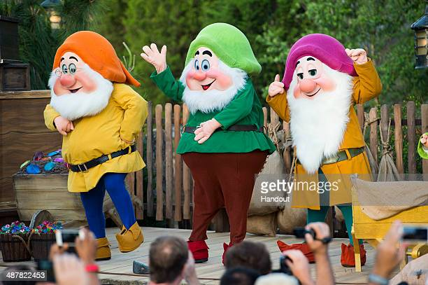In this handout photo provided by Disney Disney characters Doc Happy Dwarf and Sleepy Dwarf take the stage to help dedicate the park's newest...