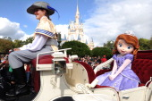In this handout photo provided by Disney Disney Junior princess 'Sofia the First' takes a royal ride in a horsedrawn carriage while taping the...
