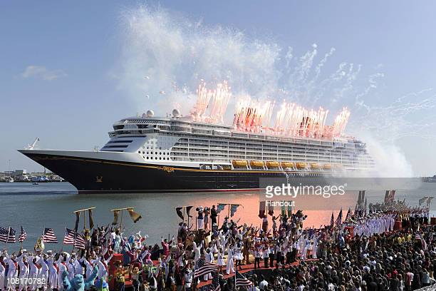 In this handout photo provided by Disney fireworks explode over the new 'Disney Dream' during the christening ceremony for the new cruise ship on...
