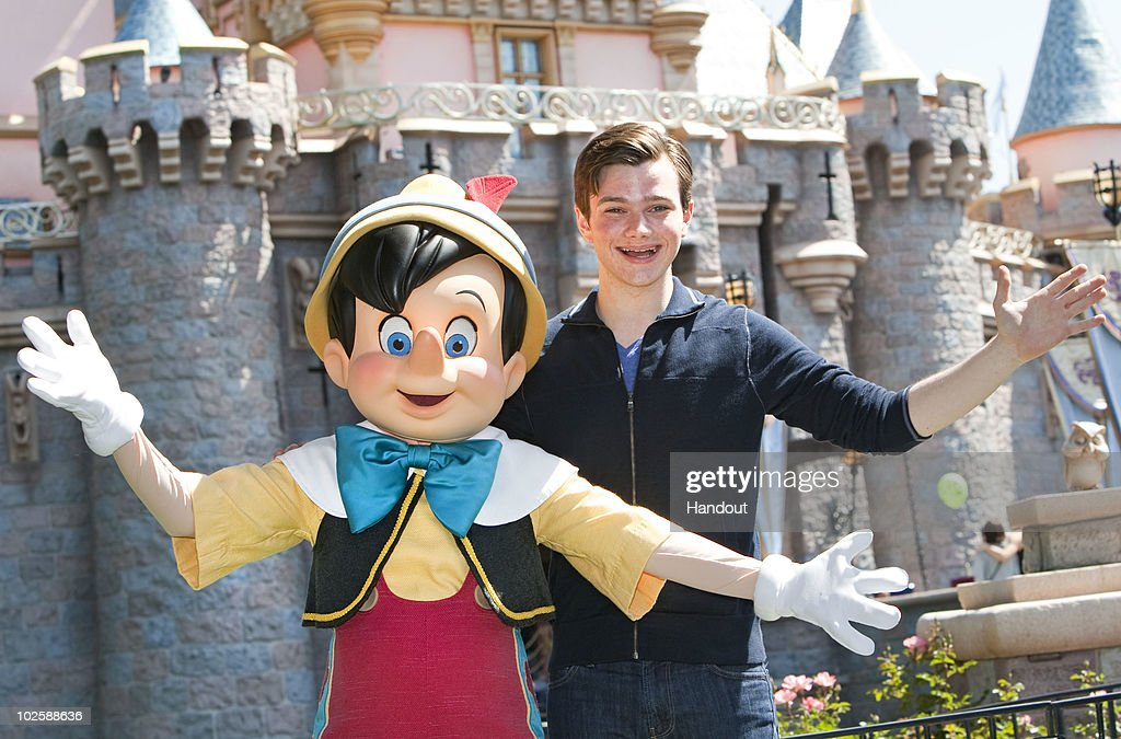 In this handout photo provided by Disney 'Glee' star Chris Colfer meets his favorite Disney character Pinocchio at Disneyland on July 2 2010 in...