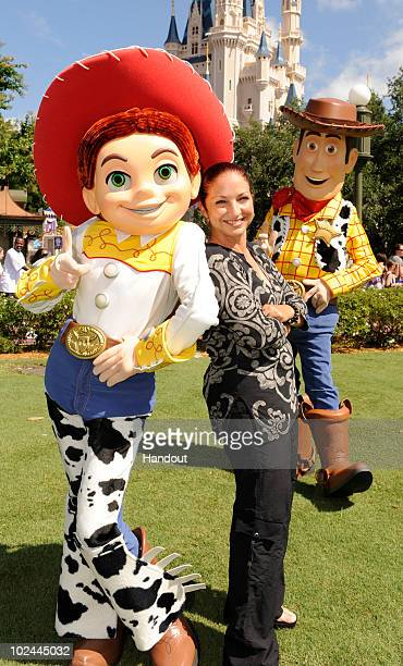 In this handout photo provided by Disney Grammy Awardwinning singer Gloria Estefan poses with 'Toy Story 3' characters Jessie and Woody at the Magic...