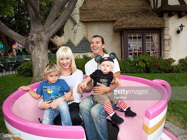 In this handout photo provided by Disney Gwen Stefani and Gavin Rossdale with their children Kingston and Zuma visit the Mad Tea Party attraction at...
