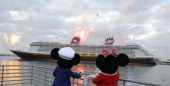 In this handout photo provided by Disney Mickey Mouse and Minnie Mouse welcome the Disney Dream Disney Cruise Line's newest ship as she arrives...